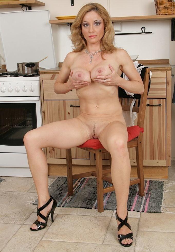 Naughty housewife posing naked