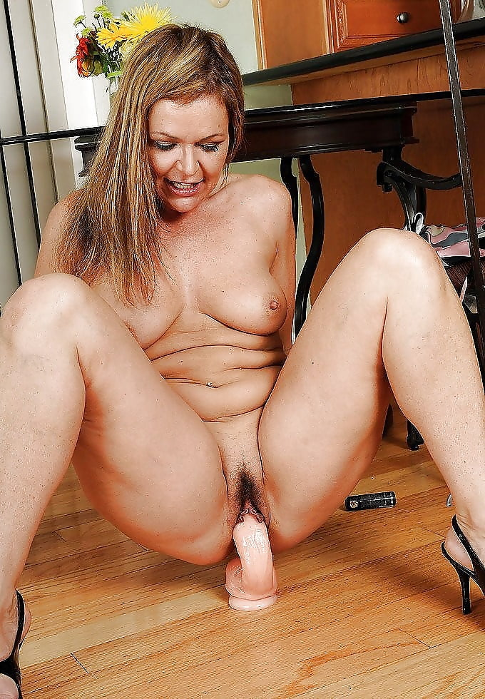 Hot middle aged woman with dildo