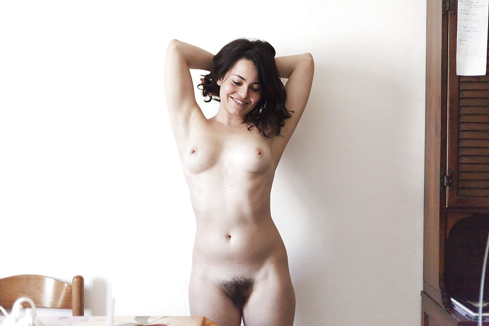 Hairy Naked Women Showing Off Her Bushy Vagina In These Free Porn Pics