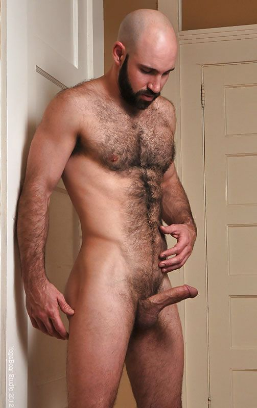 Nude man with a big hairy uncut cock