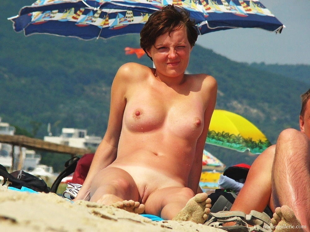 Naked milf with hairy pussy pussy on the beach