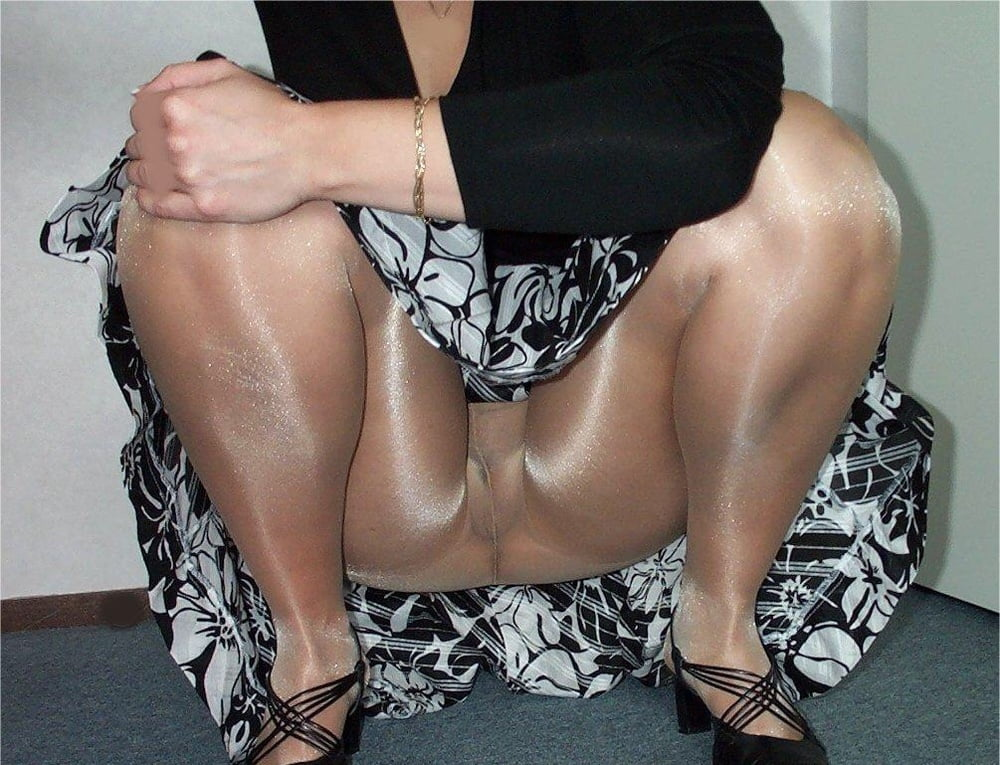 Nylon upskirt on smoking female