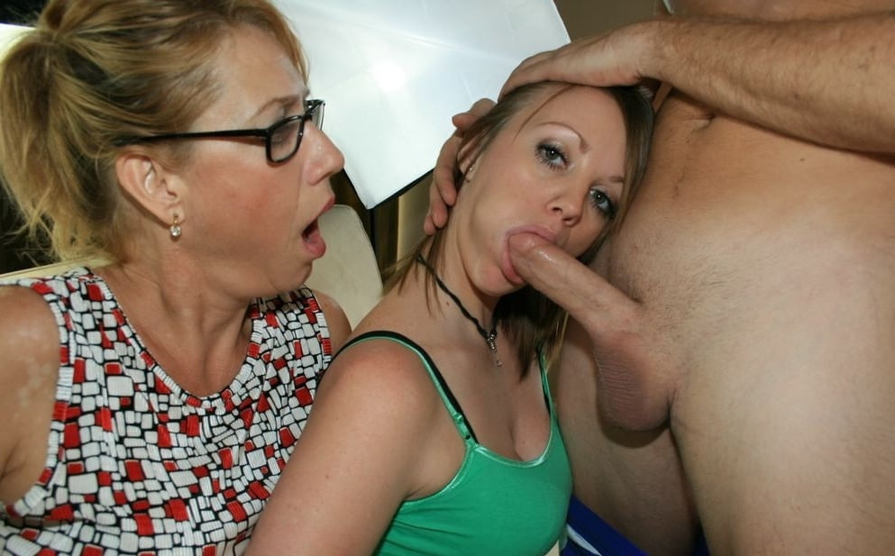 mom-and-daughter-giving-oral-sex