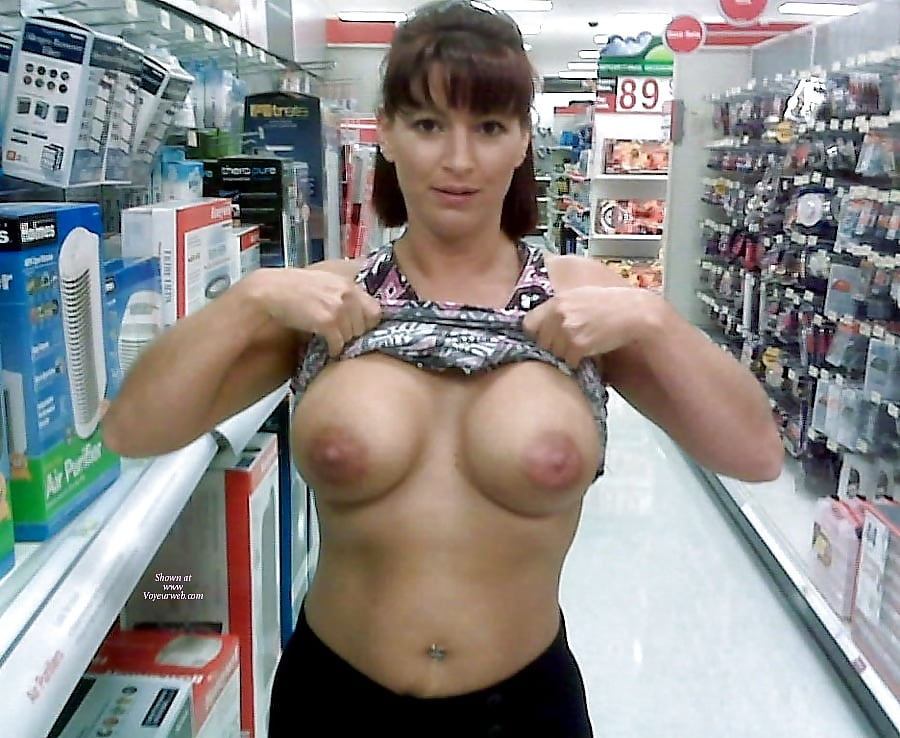 Two big tits amateurs flash in store