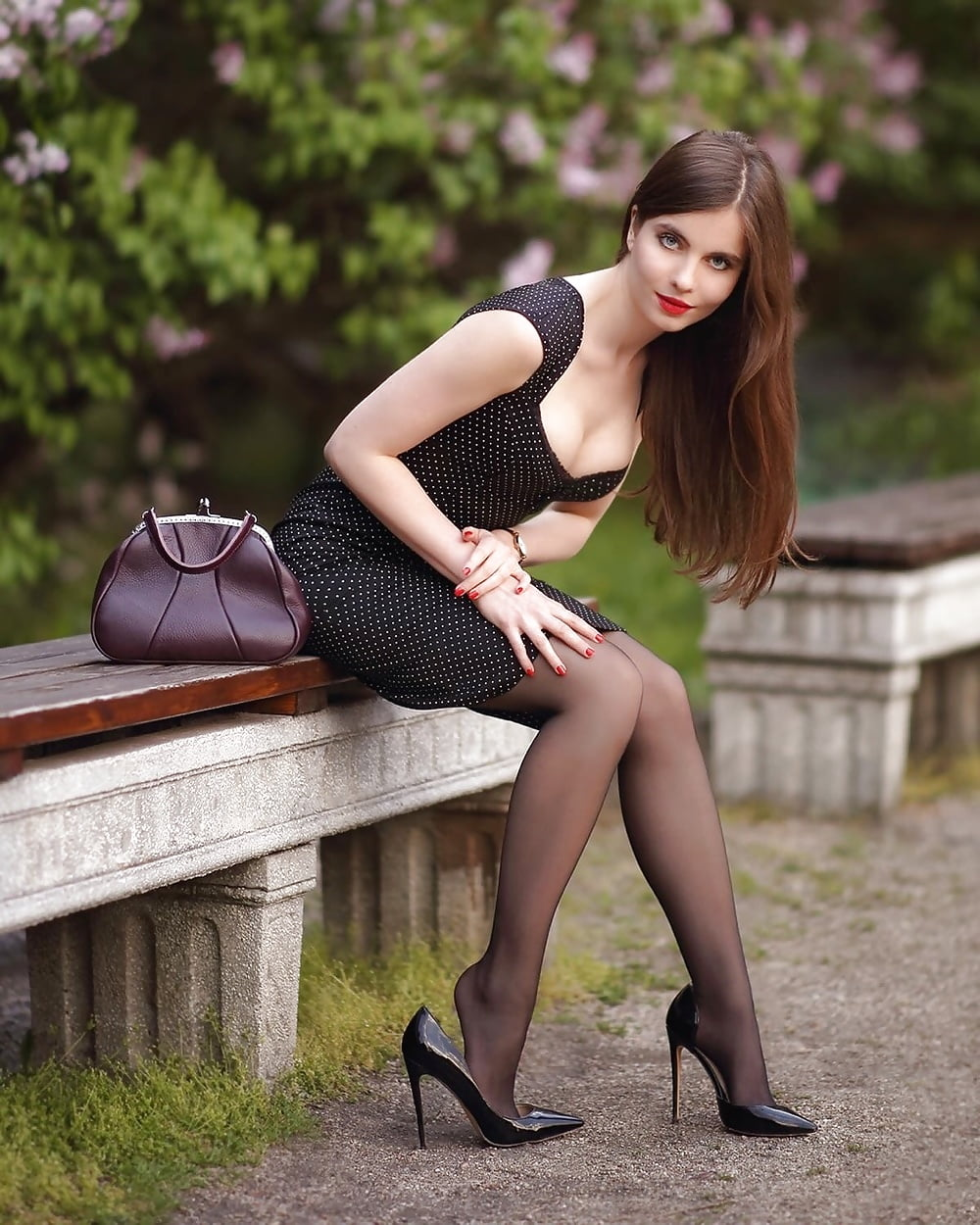 Sexy girl in corset and pantyhose posing beside a window stock photo