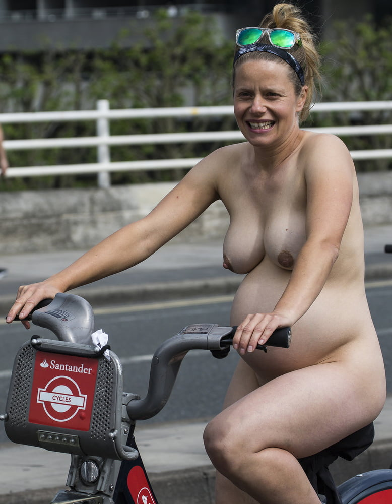 Very pregnant nude on bike