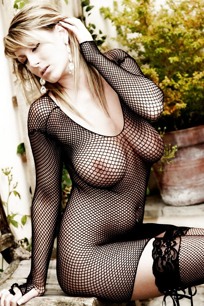 Topless Juggy Milf In Fishnets And Thongs Revealing Her Juicy Gash