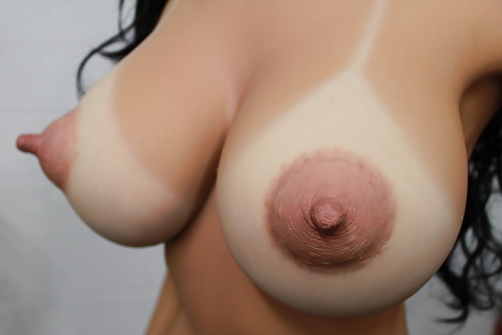 Long hard naked nipples