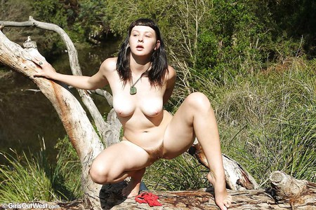Dark haired amateur shows her hairy pussy