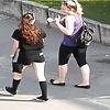 candid teen in black leggings