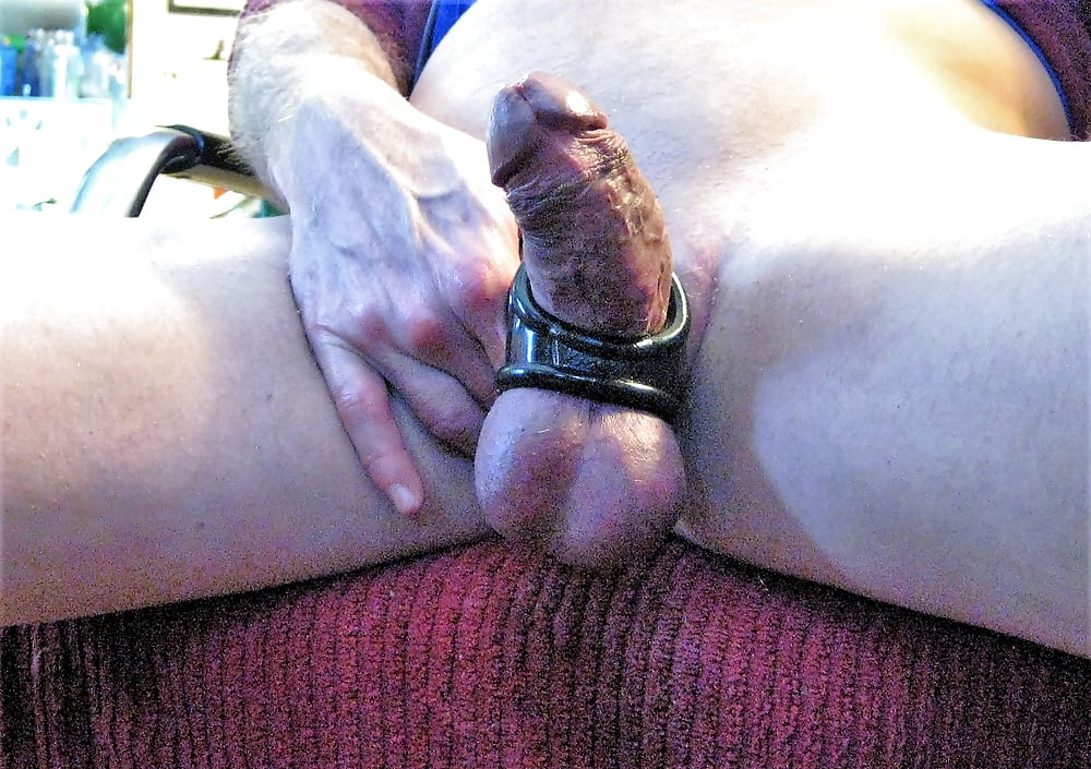 Tied and stretched cock and balls