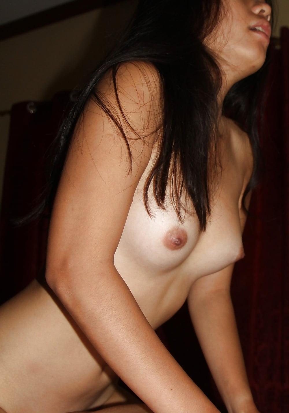Teen asian shows off thong