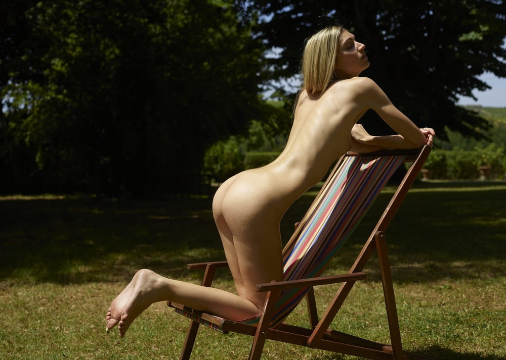 Rear view of tall blonde nude
