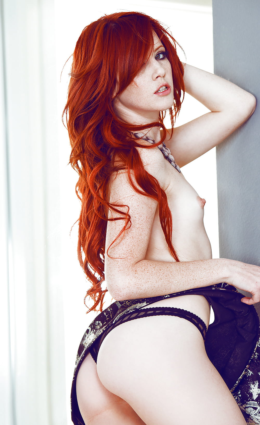 Biebel sexy redhead dances naked oil bikini naked