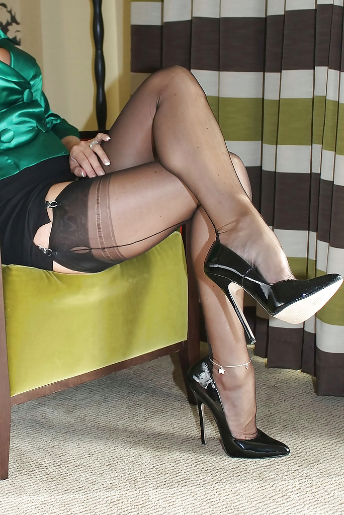 Old woman wearing stocking and high heels