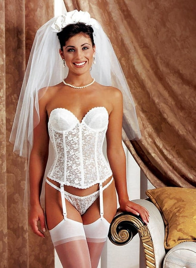 Sexy bride on armchair stock photo
