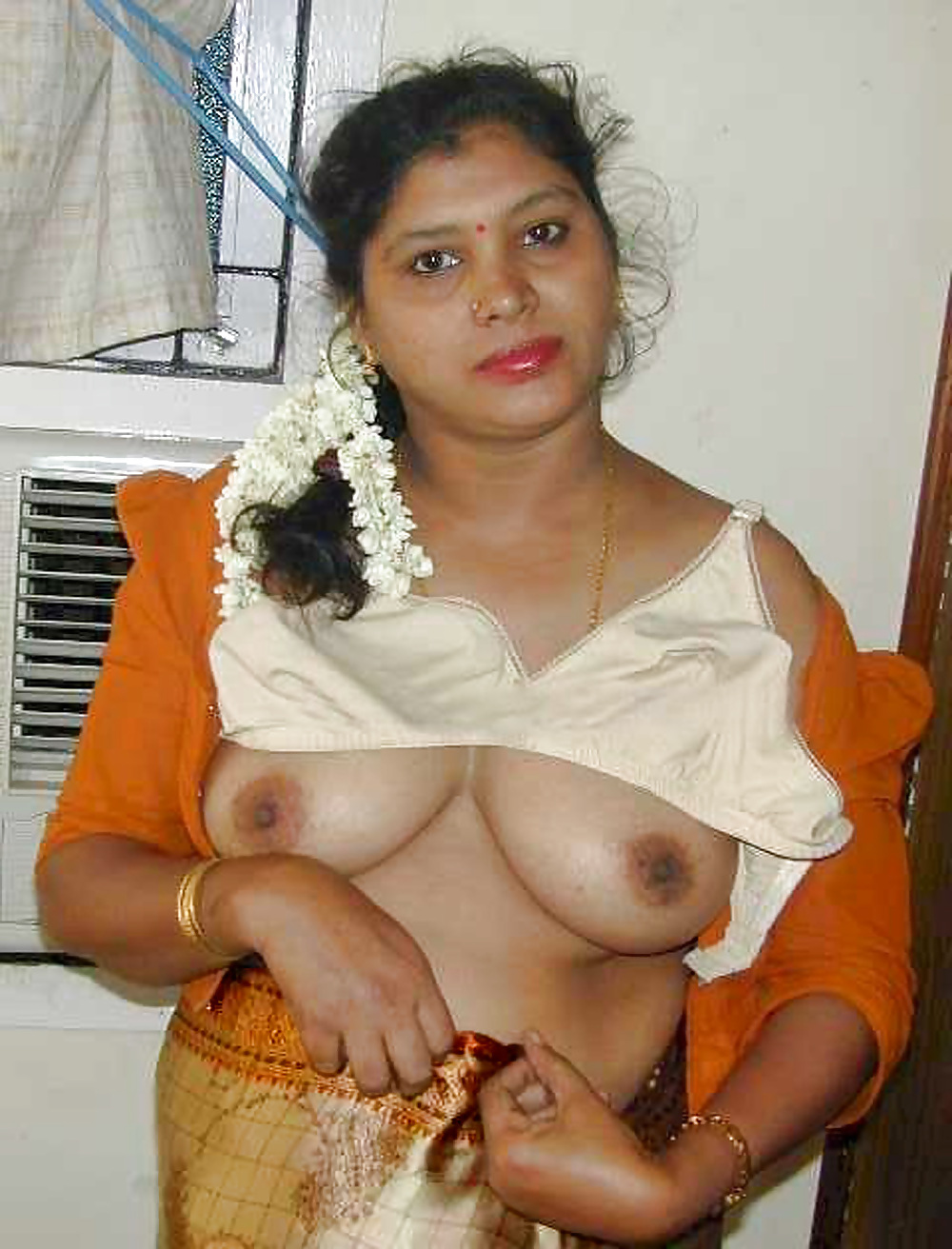 South indian aunties naked with flowers in head — img 12