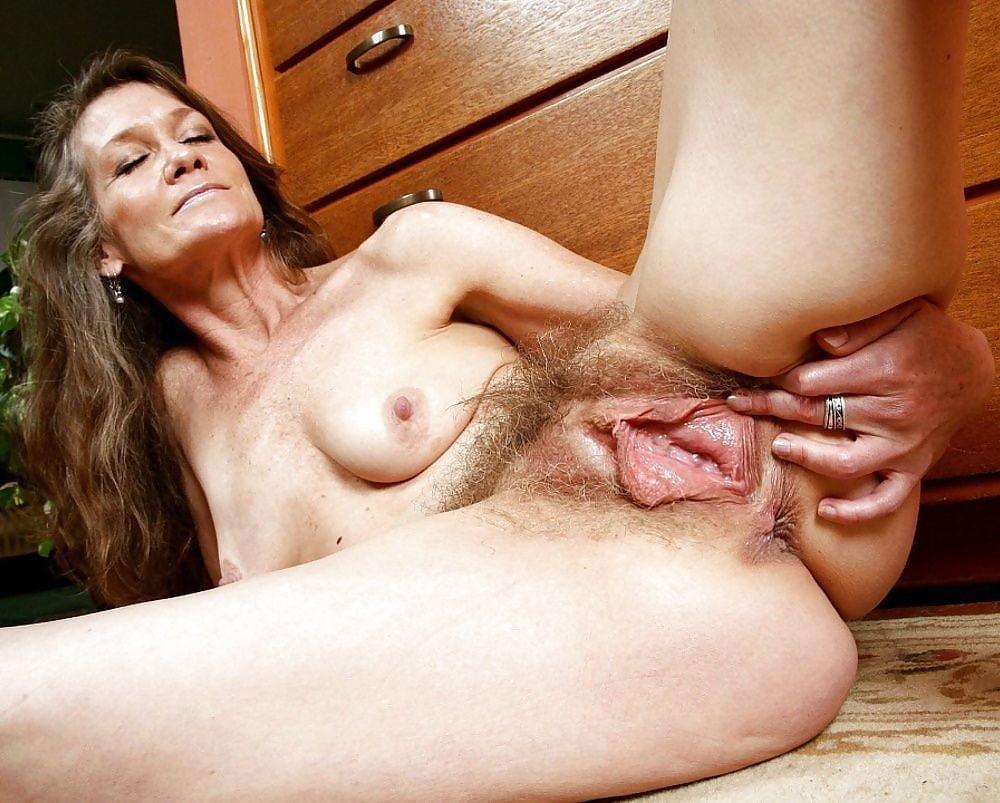 Brunette milf mariona shows hairy beaver in naked upskirt spreads lips nude