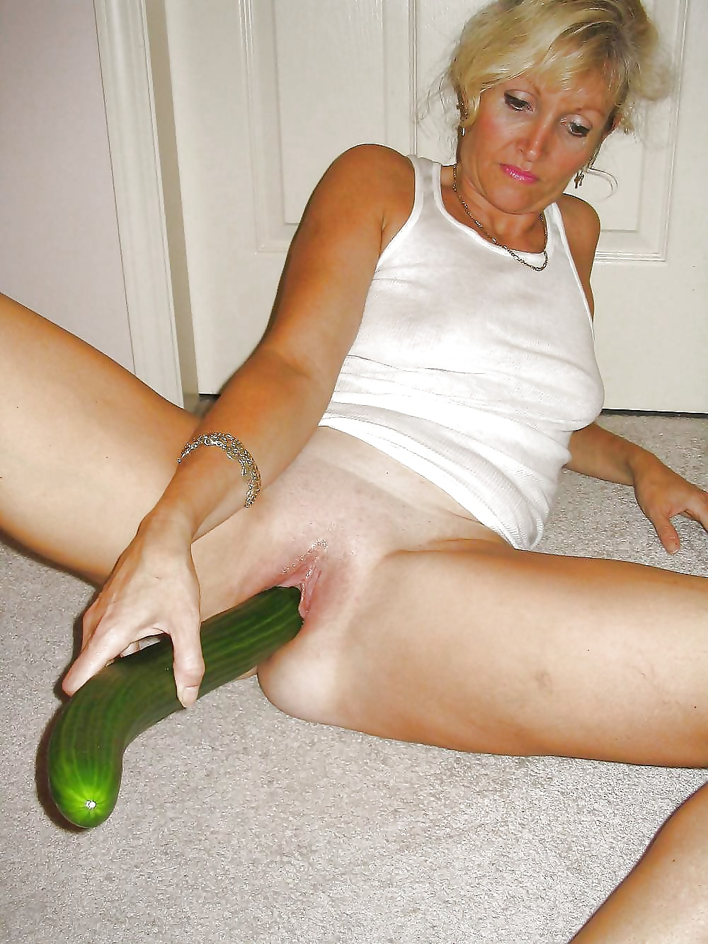Mature couples using cucumbers as sex toys