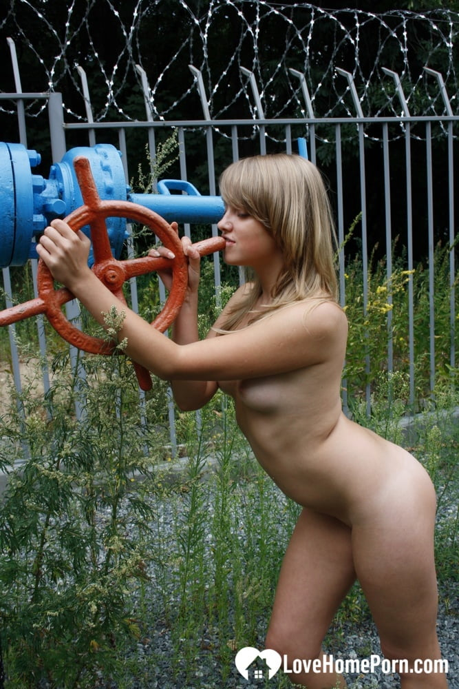 Lovely blonde posing naked at the water station - 175 Pics
