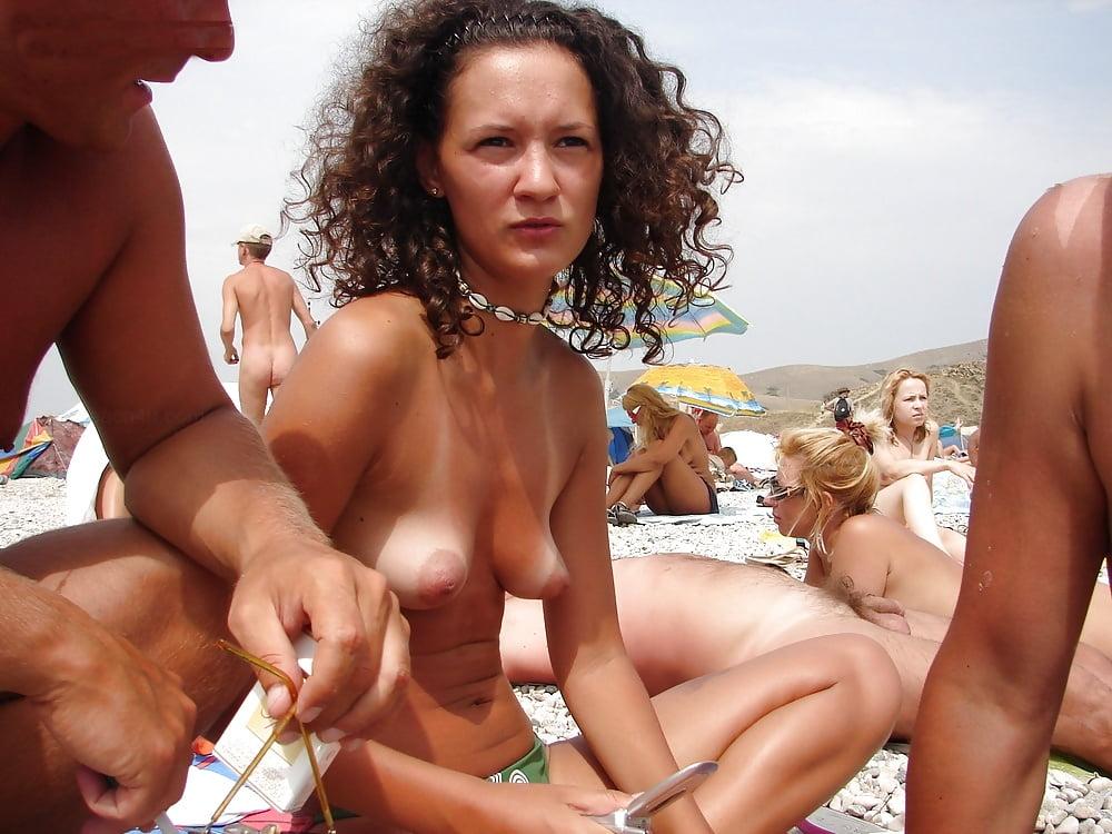 Wife gives handjob on public beach