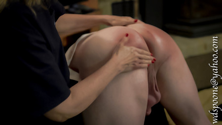 Accross her knee spank spank whack