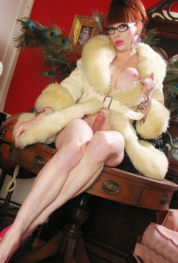 Tranny in mink coat takes male slave indoors for cock su