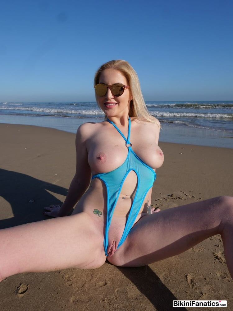 Blonde loves showing of her extreme bikini - 12 Pics