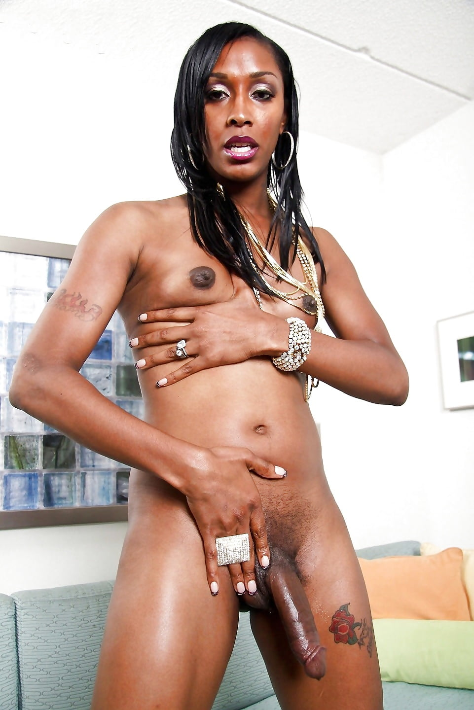 Smalltitted Black Tranny Solo Stroking Cock