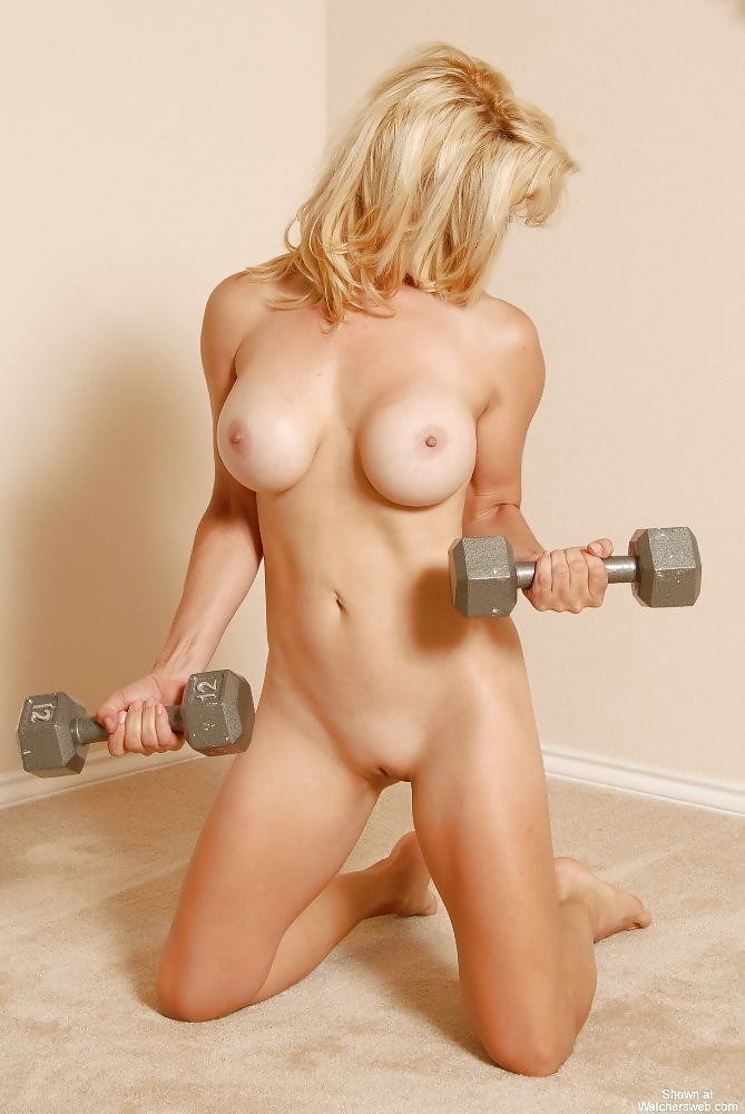 Sexy blonde doing nude workout