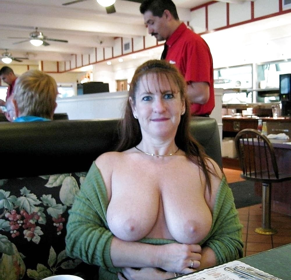 Mature flashes boobs