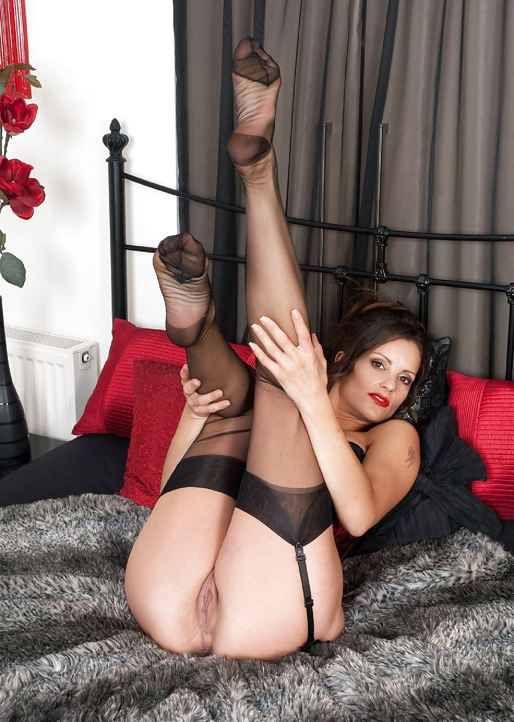Tammy is stunning in black nylon and white stockings