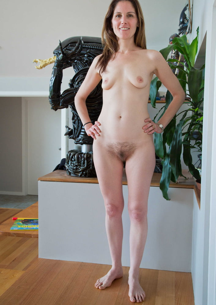 Naked mature woman standing #1
