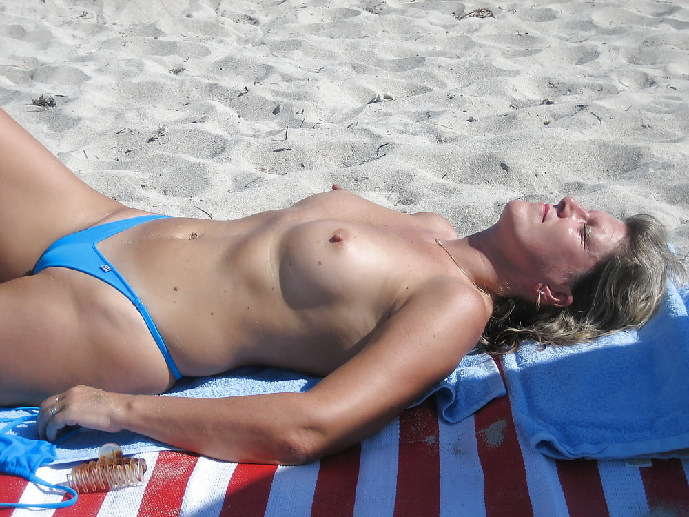 world-nude-topless-sunbathing-sunbather-pics-passed-out