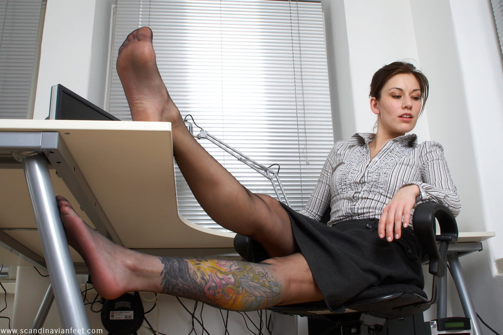 Two girls in pantyhose cater to office employee's foot fetish