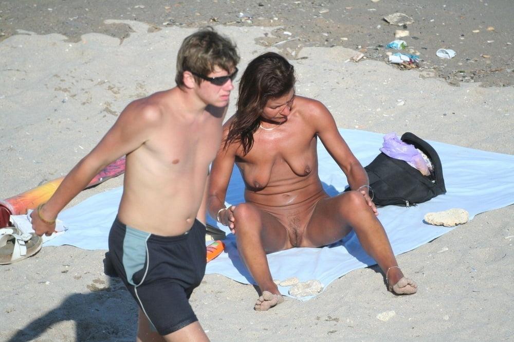 Top naked milf on the fkk beach