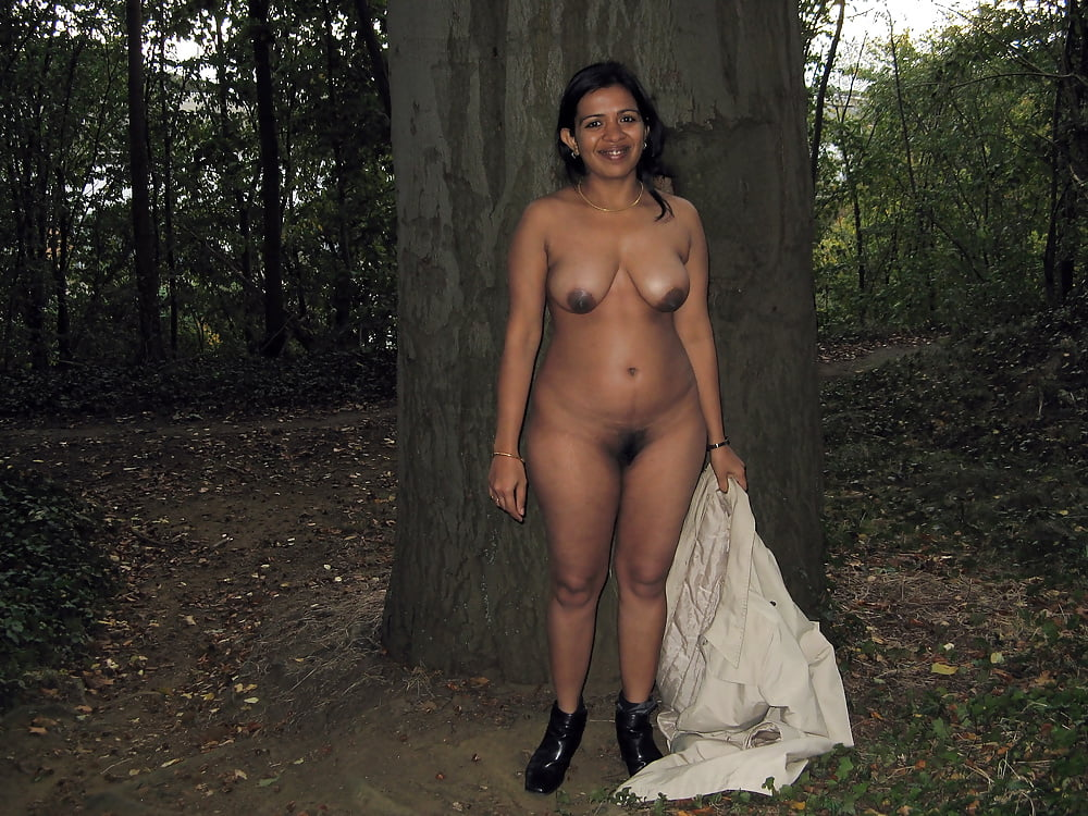 Light indian girl nude in forest