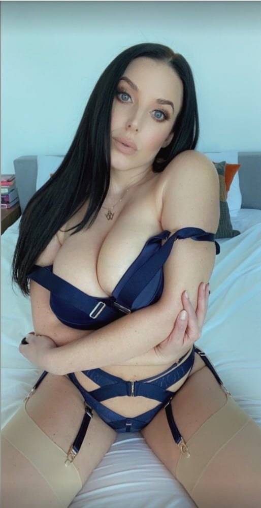 Angela White in blue lingerie with stockings