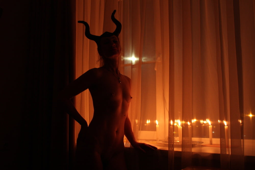Naked Maleficent with Candles - 24 Pics