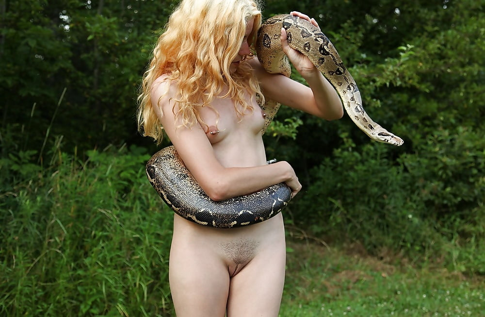 Bald bitch gets wild with snakes