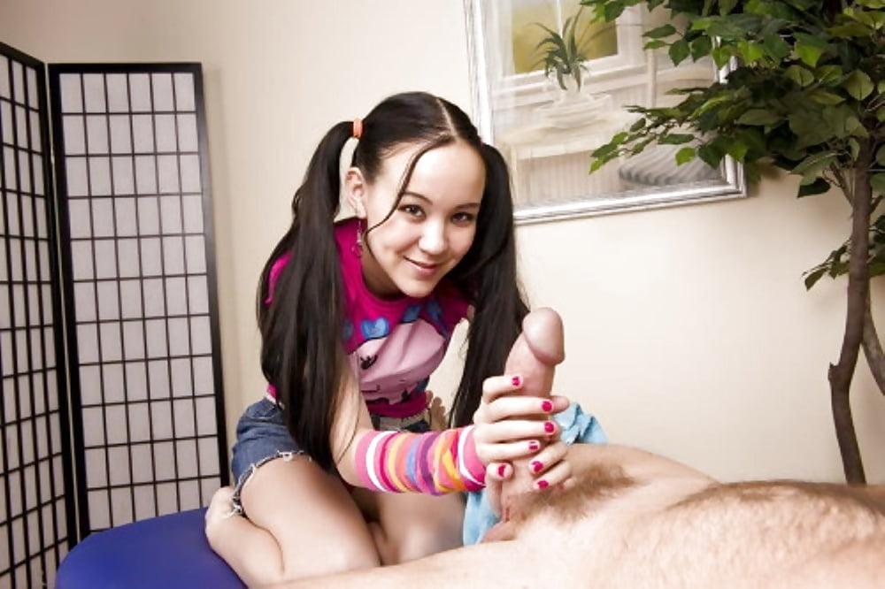 Pigtail teen double handjob