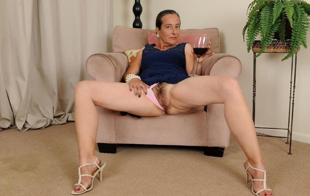 Beautiful legs mature woman sitting sexy stock photo