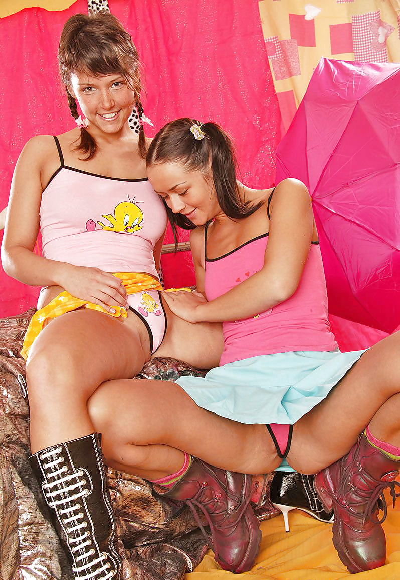 Three lesbians playing with a dildo-9836
