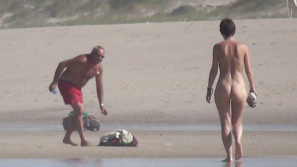 Nude girl walking on beach