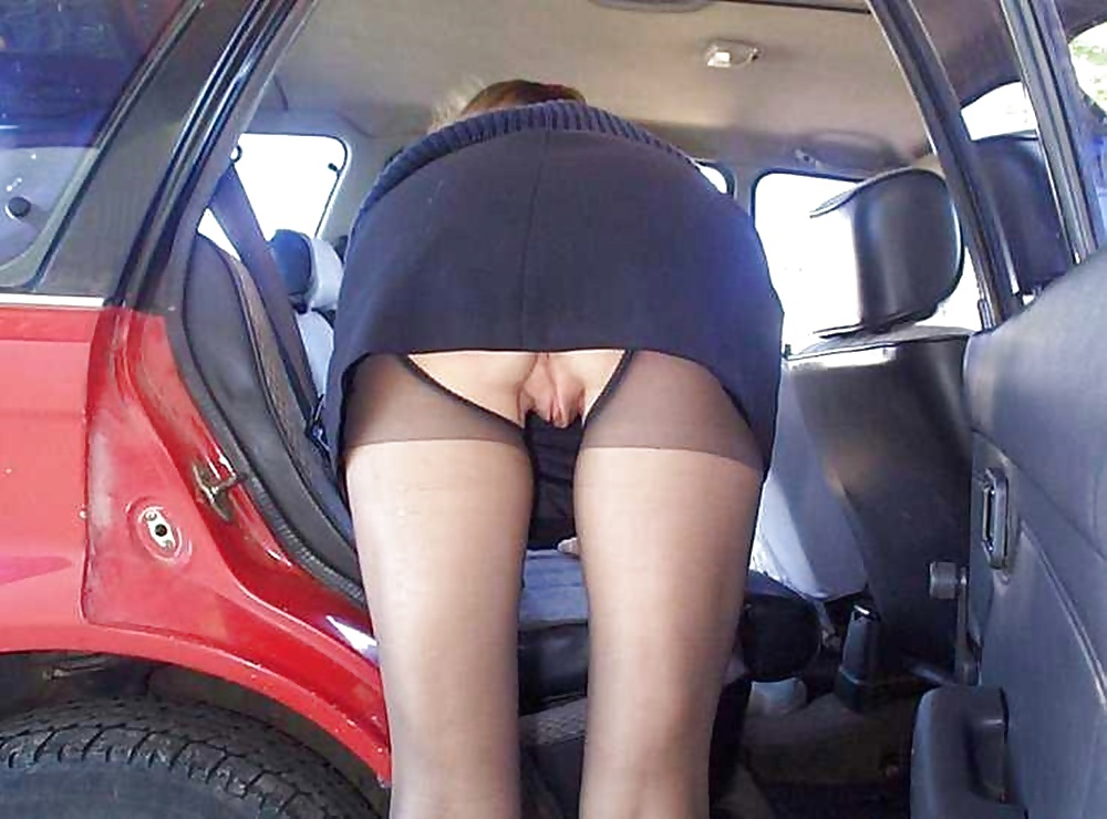 Teen girls upskirt driving a car