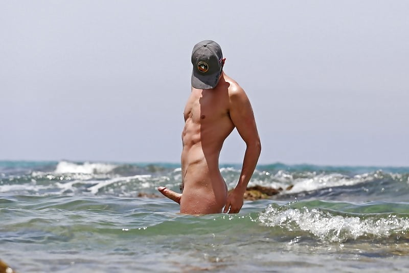 Men with erect penis at the beach