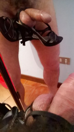Binding cock and balls with black sandals