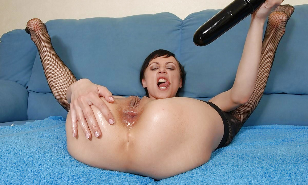 Girl fucks her ass dildo