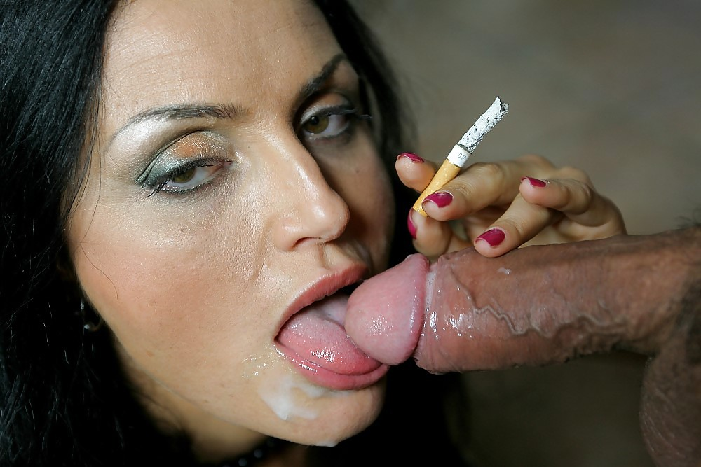 Smoking hot brunette is sucking huge dick picture