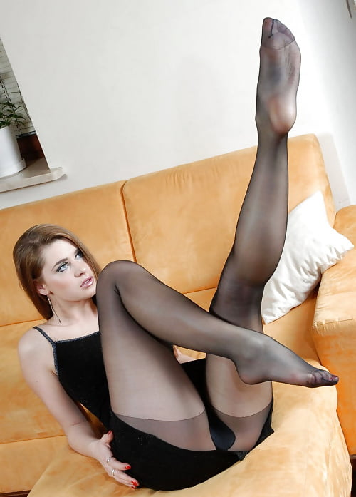 A blonde woman in stockings and short leather skirt